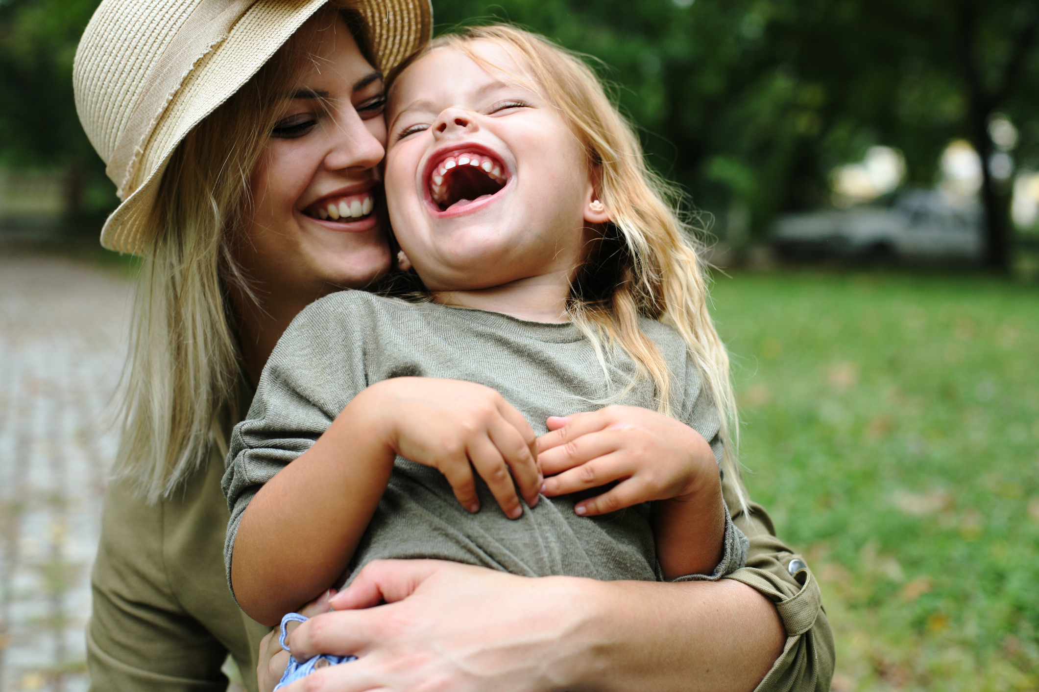 Cheerful mother with her daughter outdoor.